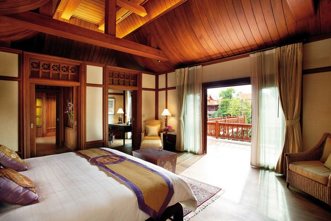 Asian-style bedroom with patio