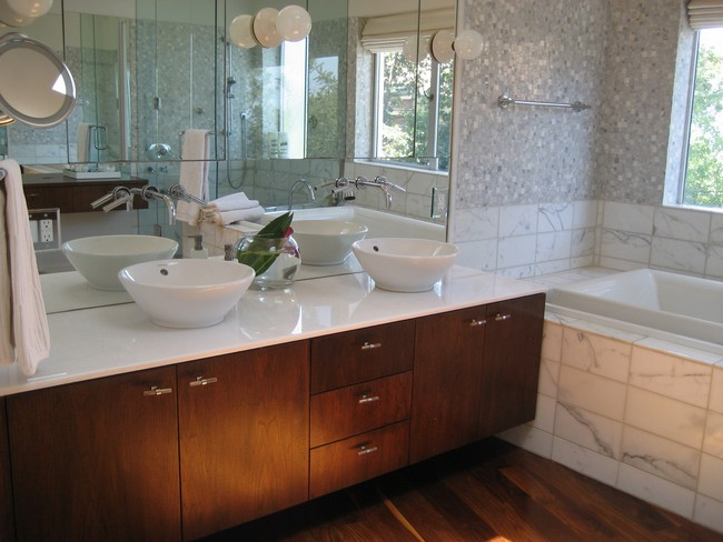 Clear white marble countertop with matching marble vessel sinks