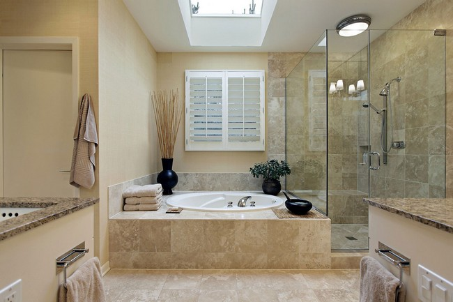 Clear-cut marble bathroom design with skylight overhead the bathtub