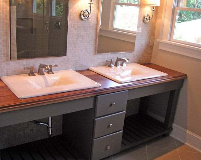 Brown wooden countertop with two white, marble sinks