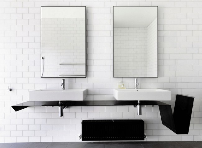 Twin mirrors placed on white subway tile