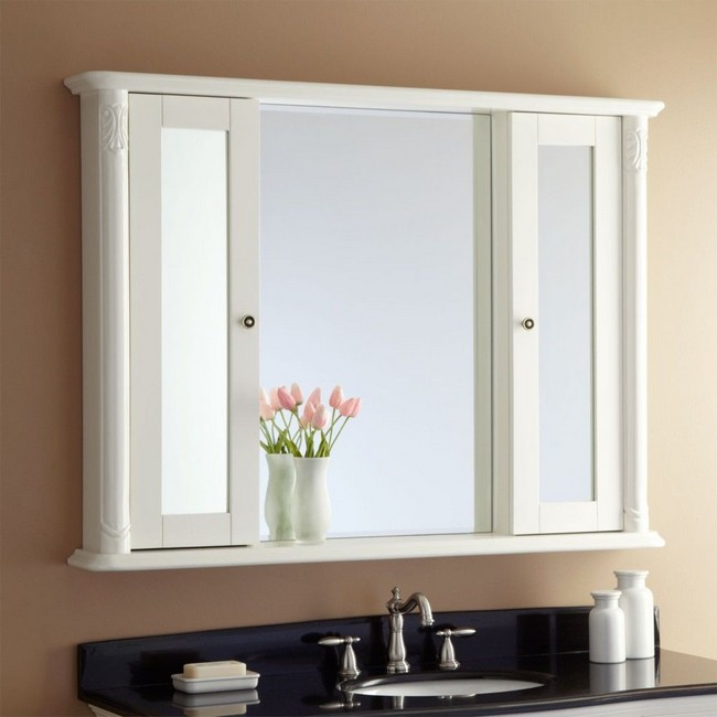 Modern mirror placed between double doors of wall cabinet