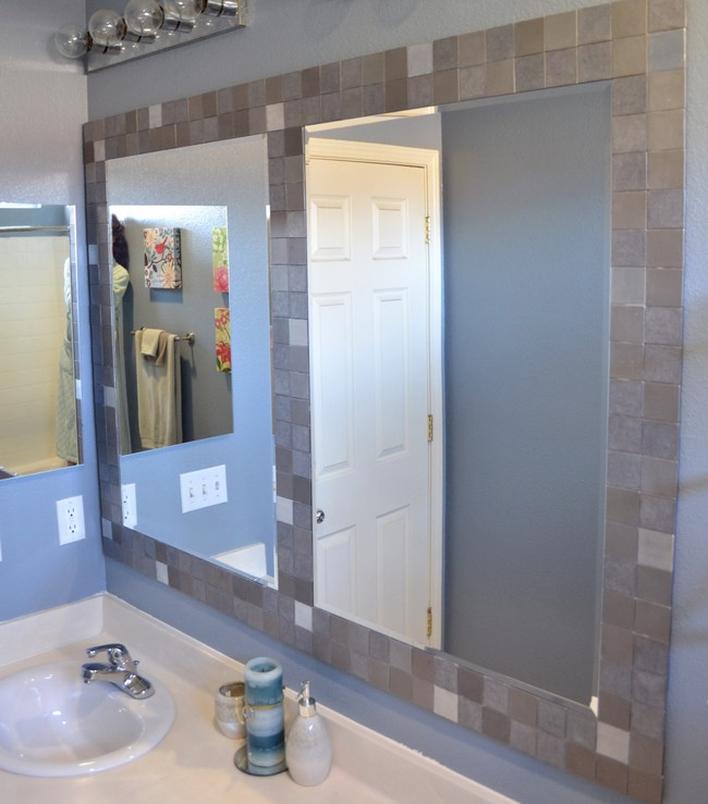 Bathroom mirror frames ideas 3 major ways we bet you didnt know ordinary mirrors in tile frame with a tile divider between them solutioingenieria