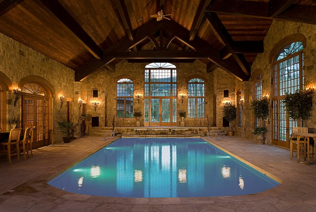 Rustic-style pool with wooden ceiling and stone floor