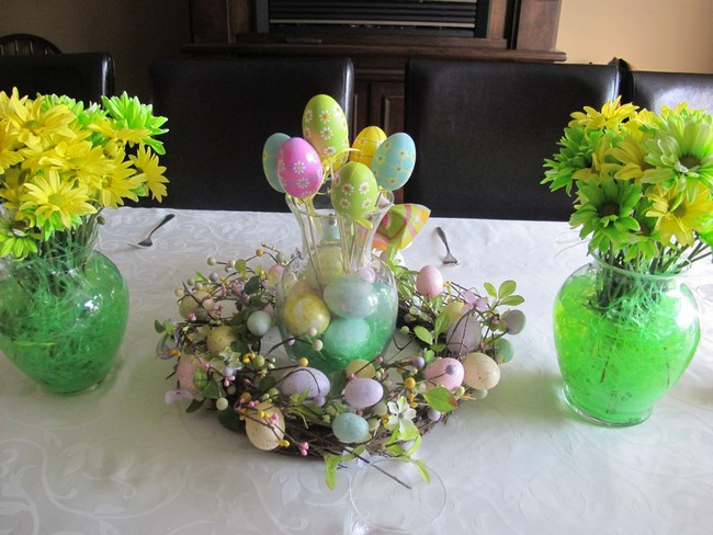 glass vase with oval egg like dcor in bright colors and patterns