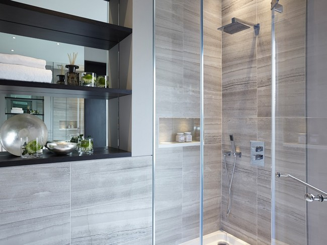 Marble bathroom with dark hardwood shelving