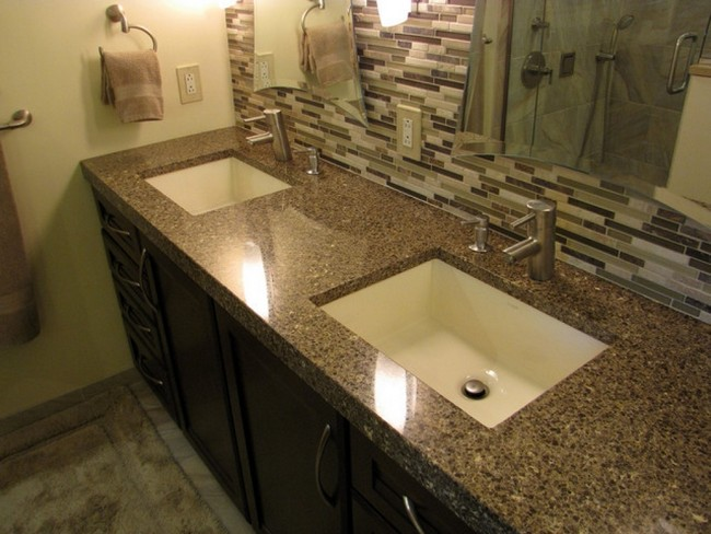 Brown countertop matching brown and white mosaic tile backsplash