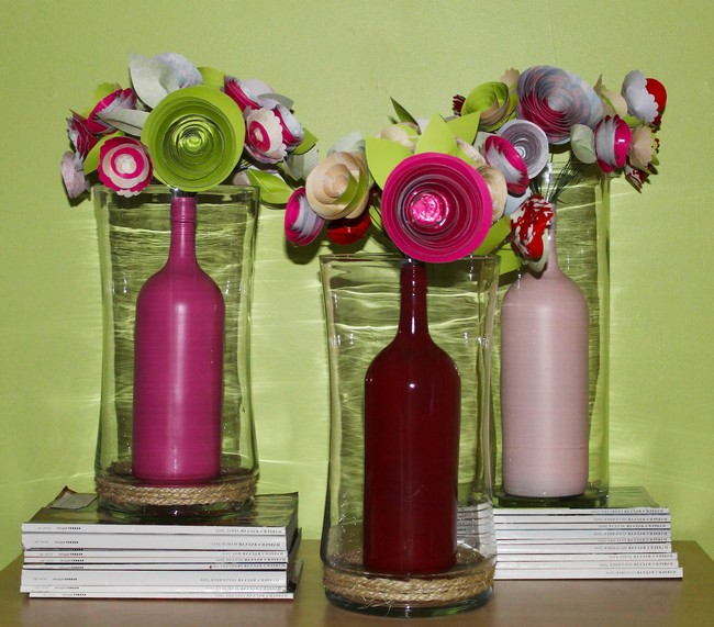 Bottles Dipped In Paint Placed Inside Glass Vase