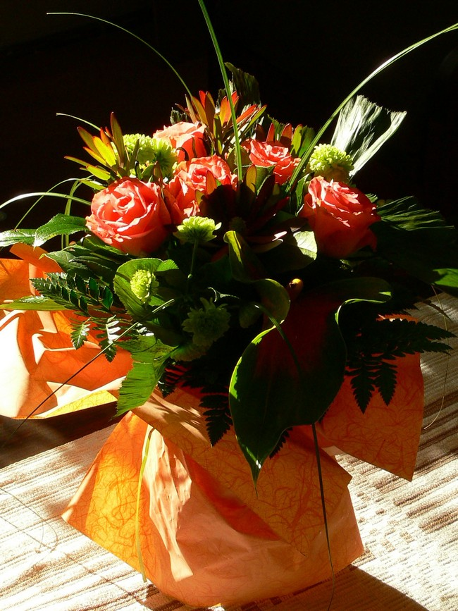 Orange fabric wrapped around ordinary vase to create elegant DIY vase