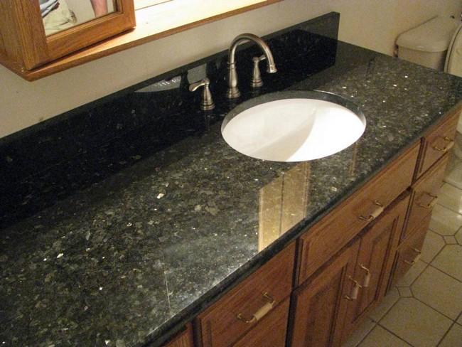 Black marble countertop with round, in-built sink