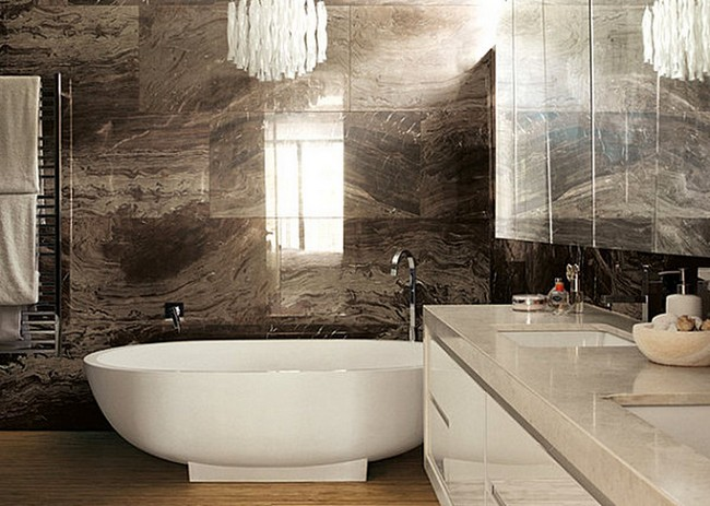Warm and cozy bathroom with large, dark brown marble tiles
