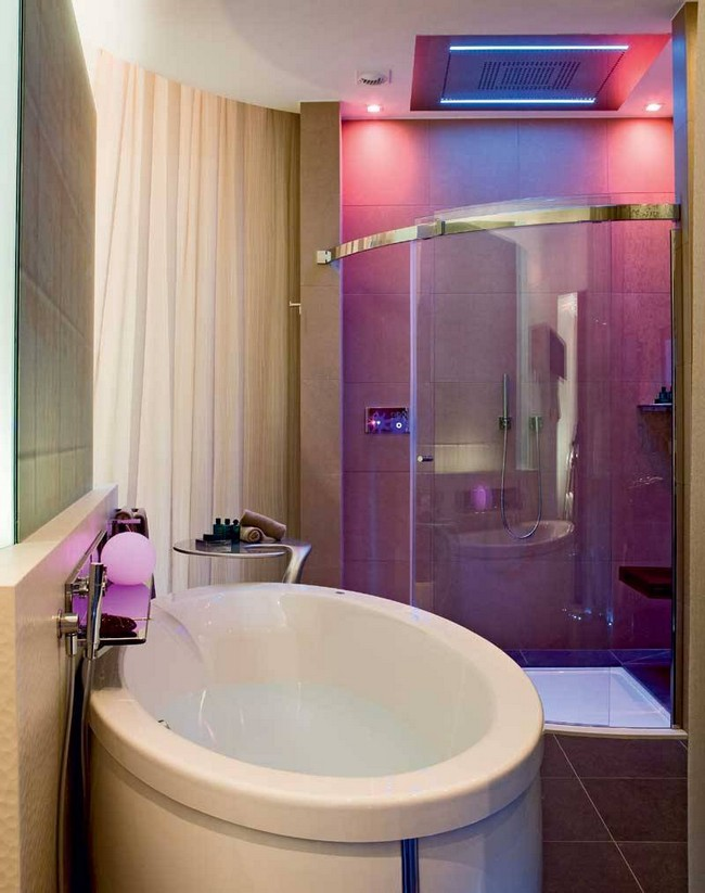 Purple in-ceiling LED lighting illuminating the entire bathroom