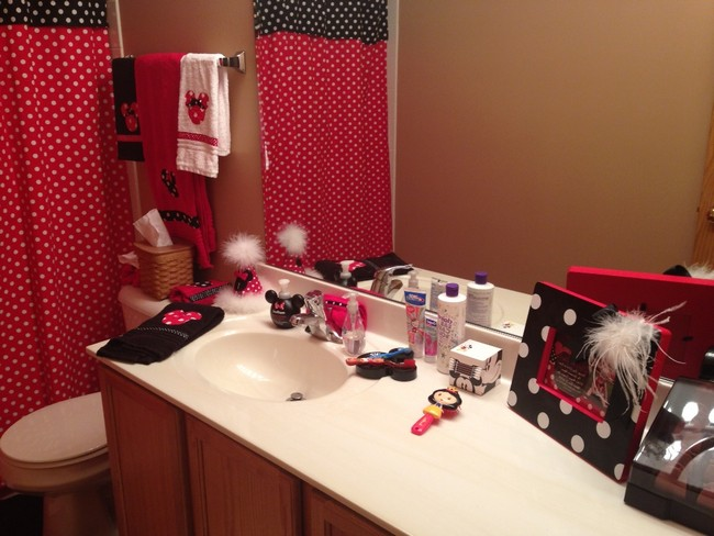 Colorful girls' bathroom with red and black polka dot accents