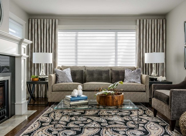 Grey curtains that complement the grey color scheme of the room