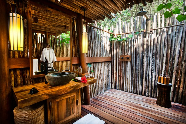 rustic bathroom design with bamboo walls and roof and elegant pendant lights - Outdoor Bathroom