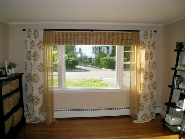 Parted White Curtains With Bold Brown Patterns