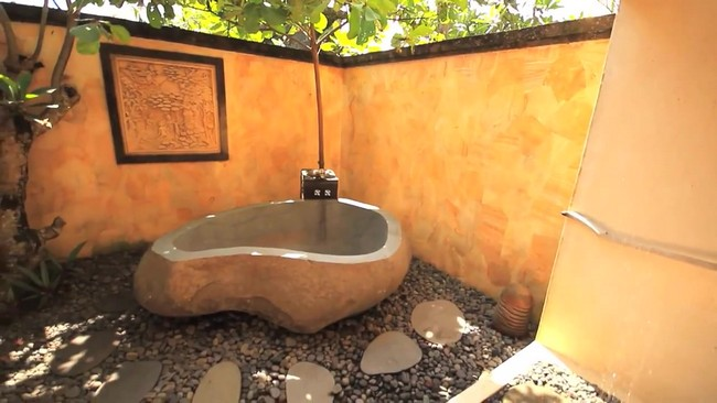 Large outdoor tub bathroom in neutral color shades