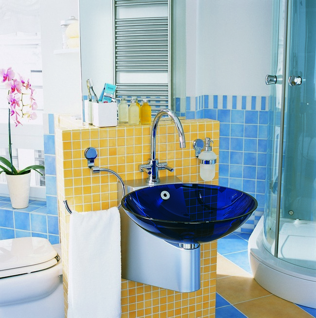 Small bathroom with cream and blue tiles