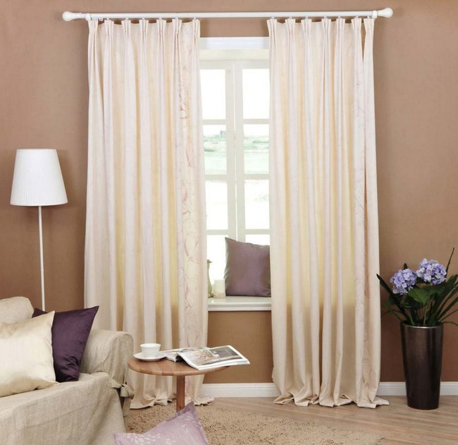Long, flowy floor-length curtains with interesting design