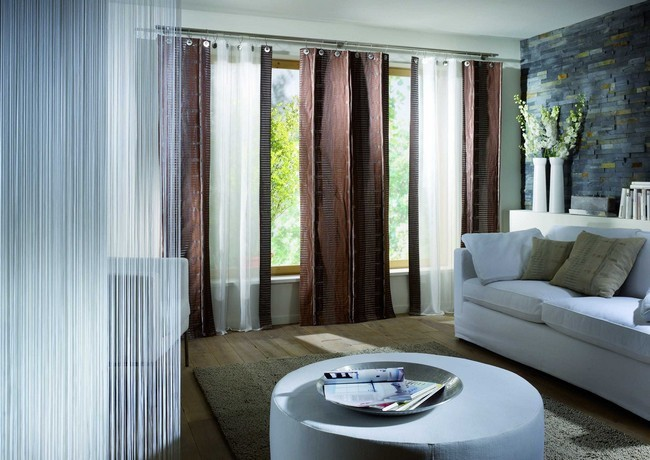 Pale Blue Curtains That Contrast The Color Scheme Of The Roomliving Room Curtain Ideas