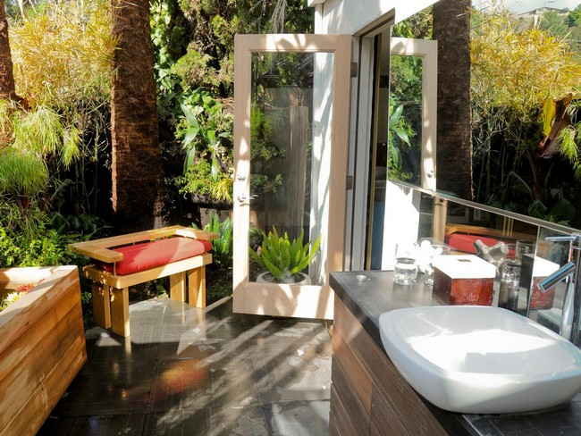 Bright outdoor shower area with stand-alone sink and modern vanity set