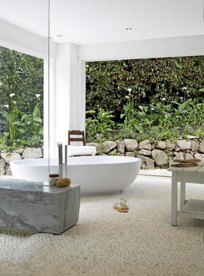 Spa-like outdoor bathroom with stone floor