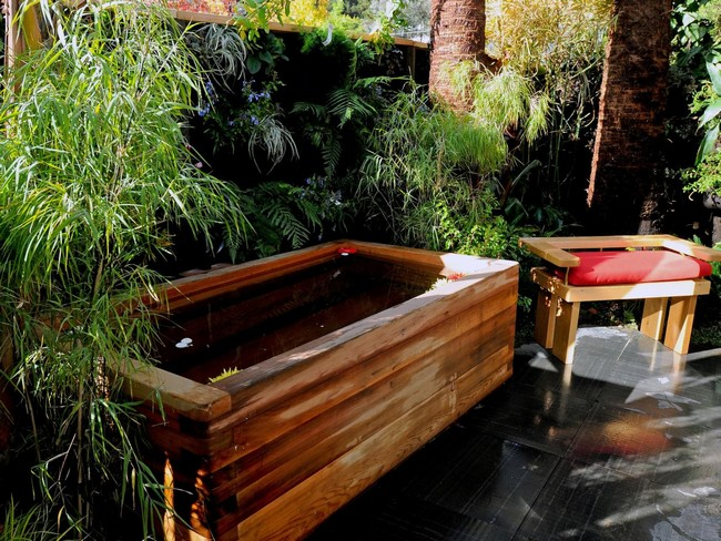 Wooden tub surrounded by large trees