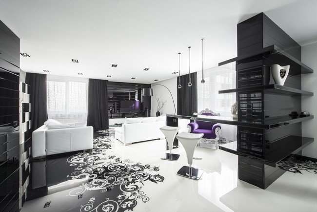 Simple black and white color palette with artistic imprint on the floor and in-ceiling lighting