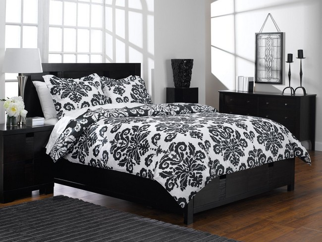 Black and white patterned bedding that adds a playful touch to the room