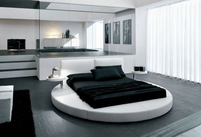 Spacious black and white bedroom with contemporary and minimalist design