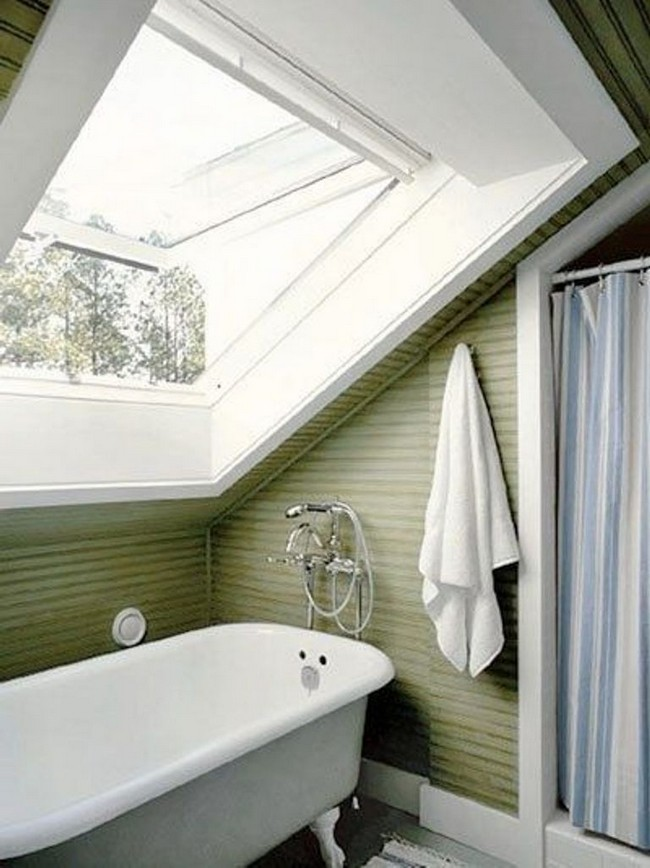 Little clutter helps this bathroom with a slanted ceiling feel more spacious