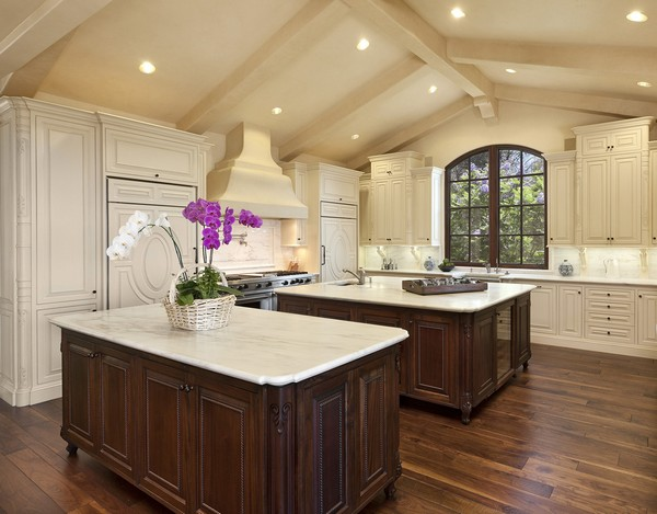 Two large islands with elegant cabinets that have exquisite trims and finishes