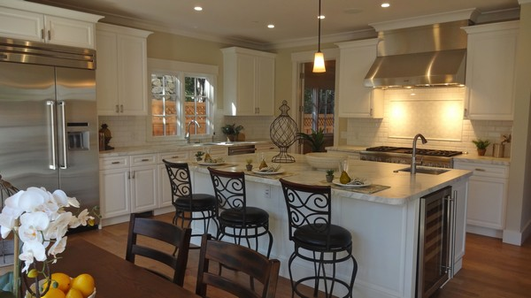 Casual Spanish-style kitchen with upholstered bronze chairs