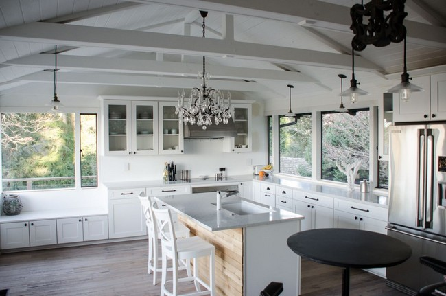 Series of wooden beams across slanted ceiling help merge a rustic style with a contemporary style