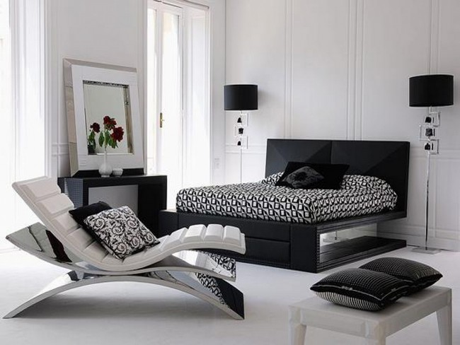 Black headboard against a white wall for a simple yet elegant appeal.