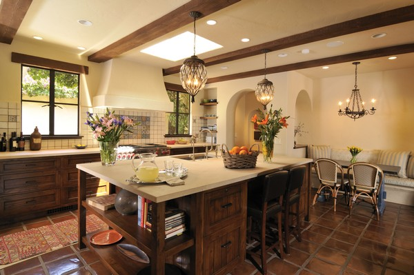 Series of wooden beams on the ceiling, a common aspect of Spanish style kitchen design