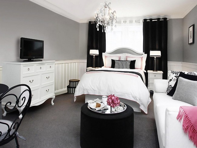 White bedroom with black accent features and accessories, creating an edgy and contemporary look