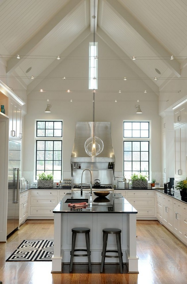 Kitchen with high slanted ceiling