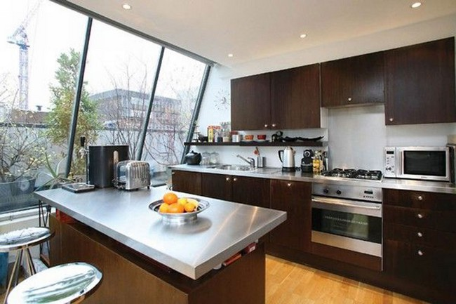Expansive slanted glass window that offers beautiful views and illuminates the kitchen
