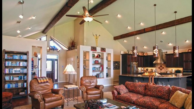 Slanted ceiling with wooden beams and pendant lighting