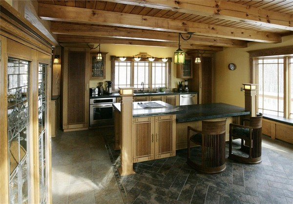 Classic Spanish style kitchen with a minimalist design, leading to a more spacious look