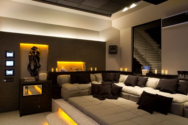 Home theater  in a black and white color scheme, with candles and LED lighting for illumination and a window with dark blinds