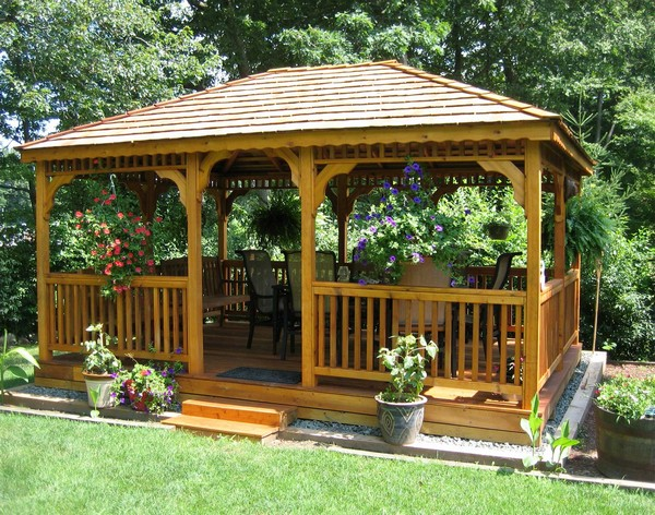 Hanging flowers in bright colors make for beautiful accessories to your gazebo