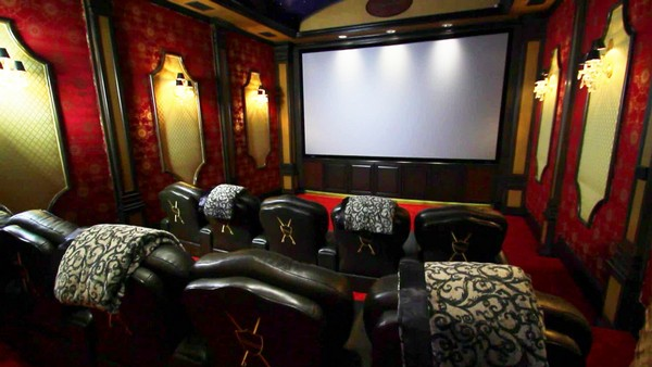 Lively and dazzling home theater design with red patterned wallpaper