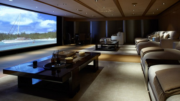 Spacious home theater with recessed in-ceiling lighting and comfy sitting arrangements