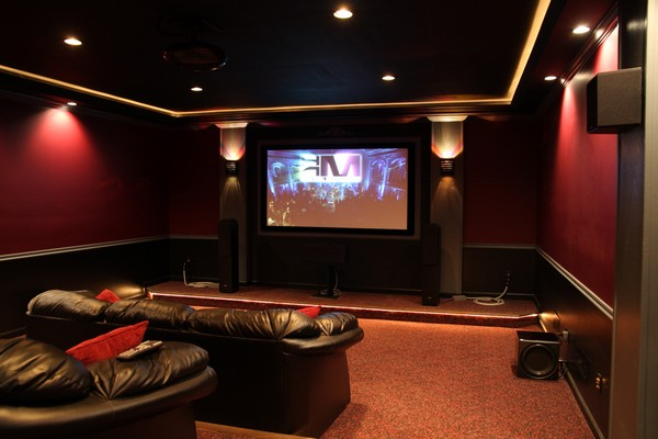 Home theater with drywall painted in bold and dark colors