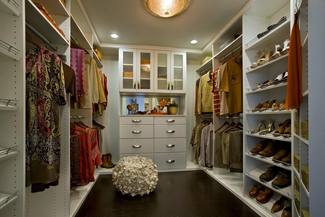 Recessed in-ceiling lighting lights up this women's closet perfectly