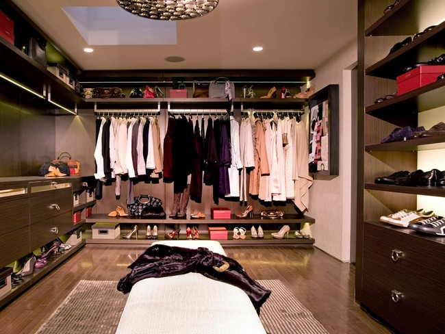 Hardwood flat-panel cabinets and shelving used to create order in this walk-in-closet