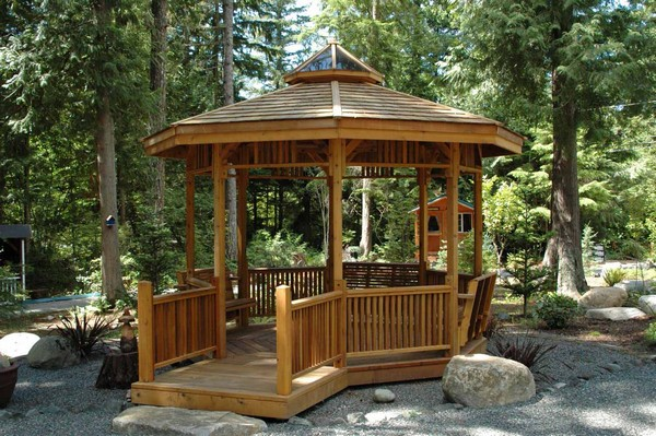 Small wooden gazebo with wooden terrace