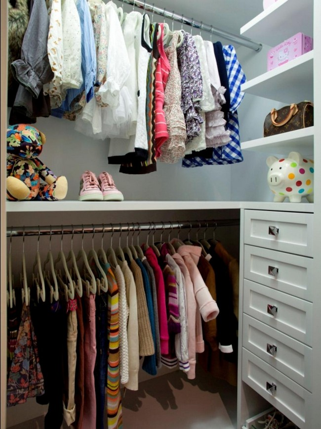 Metal rods used to hang clothes help create order and organization in this small closet